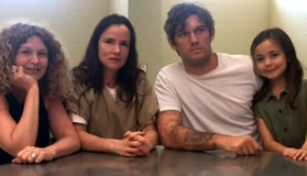 Tawni O'Dell (writer/producer), Juliette Lewis (Bonnie Altmyer), Alex Pettyfer (Haley Altmyer/director), and Hala Finley (Jody Altmyer) between takes filming the prison scene at a real prison
